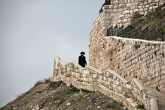 Jewish man walking down stairs in Jerusalem Royalty Free Stock Photography