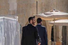 Jewish man wearing tefillin in Jewish Quarter of Old CIty Jerusalem royalty free stock images