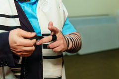 Jewish Man wrapped in tefillin pray Royalty Free Stock Photo