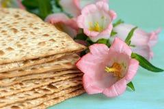 Jewish Matza bread. Pile of Jewish Matza bread next to blooming flowers Royalty Free Stock Image