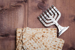 Jewish matza with menorah on table Stock Images