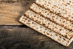 Jewish matza on Passover. On wooden background Stock Images