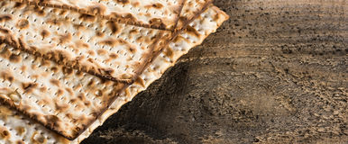 Jewish matza on Passover. On wooden background Royalty Free Stock Photography