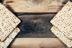 Jewish matza on Passover. On wooden background Stock Photos
