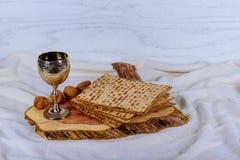 A Jewish Matzah bread with wine. Passover holiday concept. Pesah celebration concept Jewish Matzah bread with wine. Passover holiday concept Stock Photo