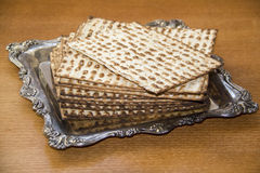 Jewish matzoh. On Decorated Silver Plate Stock Photography