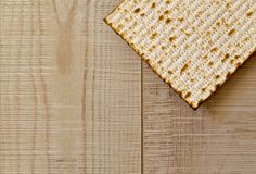Jewish Matzot on grey wooden background with copy-space.Flat Lay. Passover background. Jewish matzoh jewish passover bread over wooden background. Flat Lay Royalty Free Stock Photo