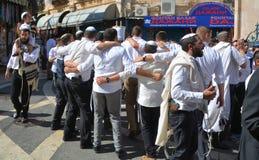 Jewish men celebrate Simchat Torah. Stock Photo