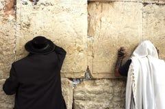Jewish Men Pray Wailing Wall. Jewish orthodox men pray at the western wall in the old city of Jerusalem, Israel Royalty Free Stock Photography
