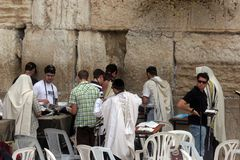 Jewish men pray at the western wall in Jerusalem Royalty Free Stock Photo