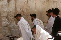 Jewish men pray at the western wall in Jerusalem Royalty Free Stock Photos