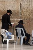 Jewish men pray at the western wall in Jerusalem Stock Image