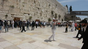 Jewish men pray at the Western Wall of the Temple Mount stock video