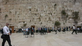 Jewish men pray at the Western Wall of the Temple Mount stock footage