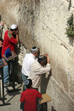 Jewish Men Pray at the Western Wall, watched by a young boy. Men Pray at the Wailing Wall Jerusalem,Israel stock image