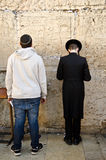 Jewish men praying. At the Western wall in Jerusalem Royalty Free Stock Photography