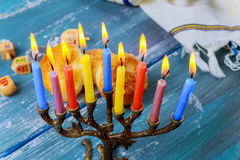 The Jewish menorah with candles, sweet donuts, Stock Image