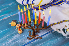 The Jewish menorah with candles, sweet donuts, Stock Photos