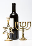 The Jewish menorah, candlestick and bottle of wine Royalty Free Stock Photo