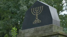 Jewish Menorah Monument. Jewwish menorah engraved monument in the cemetery stock video footage