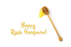 Jewish New Year holiday greeting card design with honey wooden stick. Over white background Royalty Free Stock Photo