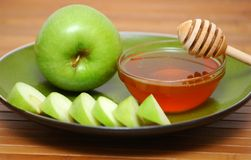 Jewish new year symbolics. Apples, honey and vine Royalty Free Stock Image