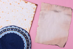 Jewish objects. A blue kippah and matzah laying next to an old piece of paper. Add your text to the paper Stock Image
