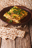 Jewish omelette: matzah brei with green onions close-up. Vertica Royalty Free Stock Images