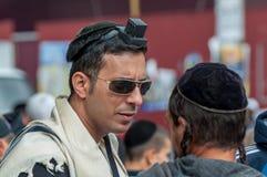 Jewish orthodox hasid wears, tefillin, tallit and kippah. Uman, Ukraine - 2 October 2016: Every year, thousands of Orthodox Bratslav Hasidic Jews from different Royalty Free Stock Photo