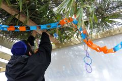 Jewish Orthodox man decorating a Sukkah. On sukkot Feast of Tabernacles, Feast of the Ingathering or Feast of booths. Copy space Stock Images