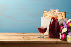Jewish Passover holiday Pesah celebration concept with matzoh and wine. Over blue background Royalty Free Stock Image