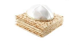 Jewish Passover holiday still life with matzoh. And kippah on white background Stock Image