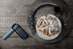 Jewish Pastry Hamantaschen and ratchet for Purim royalty free stock photo