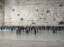 Jewish people praying at wailing wall, Jerusalem. Israel - Jerusalem - Jewish people praying at the wailing wall at night with some blurred moving silhouettes Stock Photography