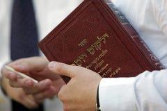 Jewish prayer, holy book, gospel, pensil. A jewish prayer holds holy book and wooden pencil in his hands Royalty Free Stock Photography