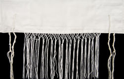 Jewish Prayer Shawl. A Jewish prayer shawl, or tallit, showing the fringes, called tzitzit Stock Photos