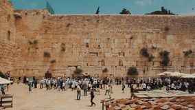 Jewish prayers at the Western wall in the old city of Jerusalem Israel stock video footage