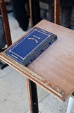 Jewish praying book. Tehilim book (Jewish praying book) with blue cover on a book stand in the Western Wall in Jerusalem, Israel Stock Photo