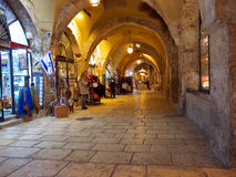 Jewish quarter bazaar in old Jerusalem. Various gift shops in the modern part of the old city. Building and pavement of Jerusalem stone. Vaults sustain the stock photo
