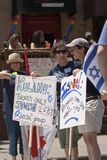 Jewish reverlers hold up up placards in support Royalty Free Stock Photography