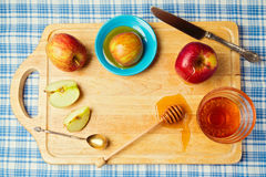 Jewish Rosh hashana (new year) holiday background with apples and honey. View from above Royalty Free Stock Image