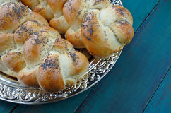 Jewish Shabbat eve table with uncovered challah bread Stock Photos