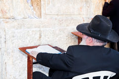 Jewish sitting and praying Stock Photos