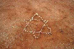 Jewish Star. Six-pointed Star of David made from pebbles Stock Image