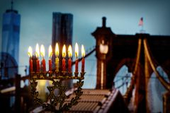 jewish symbol jewish holiday Hanukkah with menorah Brooklyn Bridg, New York City royalty free stock photography