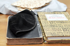 Jewish symbols. Pesach table with traditional jewish symbols - matza bread, kippah, hagada books Stock Image