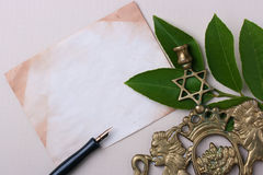 Jewish symbols. A menorah next to an old piece of paper. Add your text to the paper Royalty Free Stock Photos