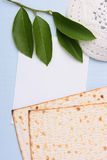 Jewish symbols. A white kippah and matzah next to a piece of white paper. Add your text to the paper Stock Photography