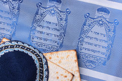 Jewish symbols. A blue kippah next to matzah and a Jewish tallit. Add your text to the background Stock Photos