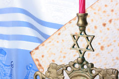 Jewish symbols. Menorah and matzah in front of a blue and white tallit. Add your text to the background Stock Photo
